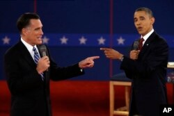 FILE - Republican presidential nominee Mitt Romney, left, and President Barack Obama spar during a presidential debate at Hofstra University in Hempstead, N.Y., Oct. 16, 2012.