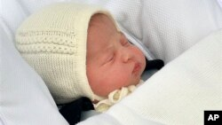 The newborn baby princess, born to parents Kate Duchess of Cambridge and Prince William, is carried in a car seat by her father from The Lindo Wing of St. Mary's Hospital, in London, May 2, 2015.