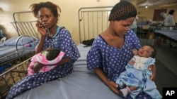 FILE - Women sit with their newborn babies in a ward of the Lagos Island Maternity Hospital in Lagos, Nigeria, Oct. 31, 2011.