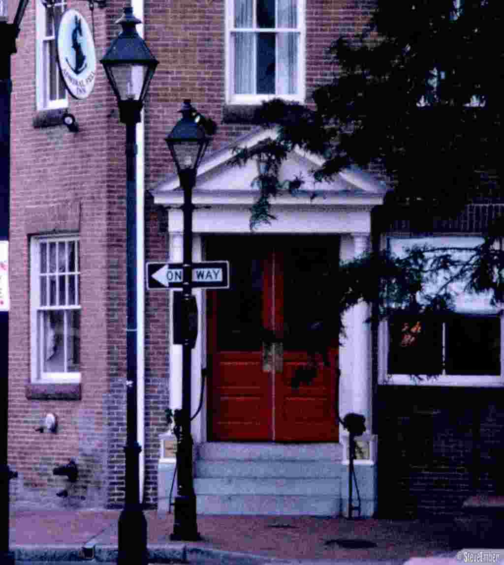 The welcoming red doors of the Admiral Fell Inn along the cobblestoned streets of Fells Point.
