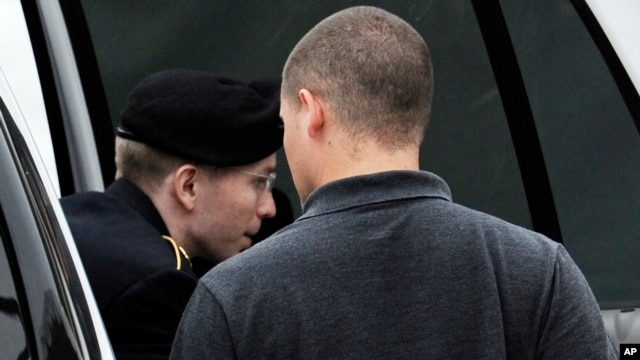 Army Pfc. Bradley Manning is escorted into a courthouse for his court marial at Fort Mead, Maryland, July 25, 2013.