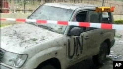 A damaged U.N. vehicle after a bomb blast at the United Nations offices in the Nigerian capital of Abuja August 26, 2011.
