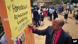 "Ugandan anti-gay activist Pastor Martin Ssempa posts public notice offering ""rehabilitation"" for homosexuals, National Theater, Kampala, Feb. 25, 2014."