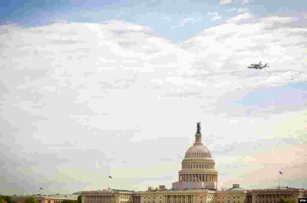 April 17: The Space Shuttle Discovery cruised over the U.S. Capitol in Washington as a part of its tour before being retired to the Smithsonian's Udvar-Hazy center in Virginia. (Alison Klein for VOA)