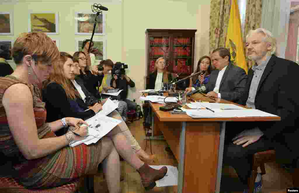WikiLeaks founder Julian Assange (right) listens as Ecuador's Foreign Affairs Minister Ricardo Patino (second from right) speaks during a news conference at the Ecuadorian embassy, in central London, Aug. 18, 2014.