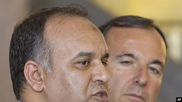 Italian foreign minister Franco Frattini , right, and vice-chairman of the Executive Board of the Libyan National Transitional Congress Ali al-Issawi talk to the media during a press conference in Rome, July 22, 2011