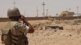 An Iraqi soldier monitors the Iraq-Syria border point, Abu Kamal, July 22, 2012.