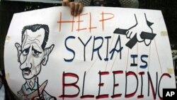 """""""Au secours! La Syrie saigne."""" Slogan lu durant une manifestation anti-Assad au Caire (29 septembre 2011)"""