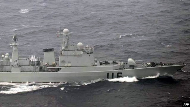 This handout picture taken by the Japanese Defense Ministry on October 16, 2012 shows a Chinese warship ship cruising in waters between two Japanese islands in Okinawa prefecture, in the East China Sea.