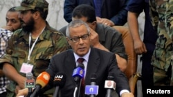 FILE - Libya's Prime Minister Ali Zeidan speaks during a signing ceremony for the law on elections of the constituent body for the drafting of a constitution in Al Bayda,July 20, 2013.
