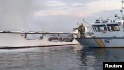 Sisa-sisa kapal Conception, kapal yang mengangkut para penyelam, pasca kebakaran di California selatan (2/9).