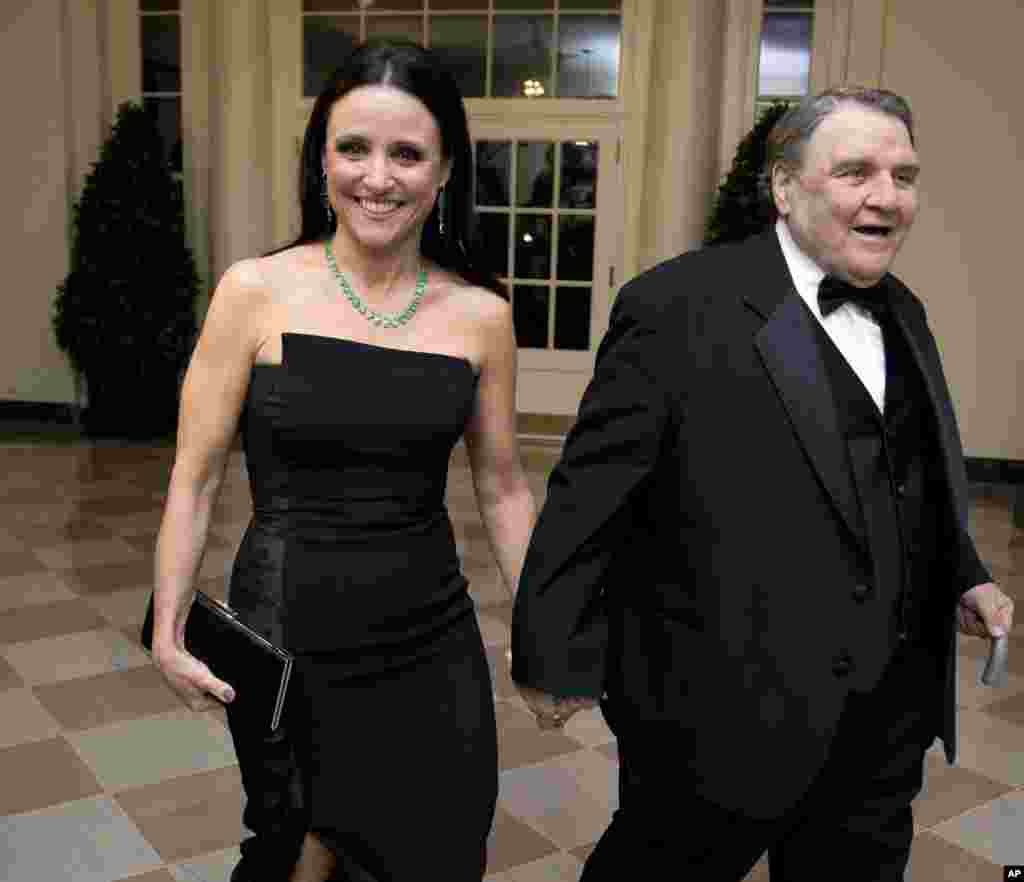 Actress Julia Louis-Dreyfus arrives for a State Dinner in honor of French President François Hollande, with her father William Louis-Dreyfus at the White House, Feb. 11, 2014.