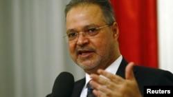 FILE - Yemeni Foreign Minister Abdel-Malek al-Mekhlafi speaks to the media after the Yemen peace talks in Switzerland in Bern, Dec. 20, 2015