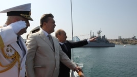 Ukrainian President Viktor Yanukovych, second left, inspects navy ships with Russian President Vladimir Putin in the Ukrainian Black Sea port of Sevastopol in the Crimea, July 28, 2013.