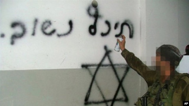 "A handout picture obtained by AFP from the Israeli human rights organization Breaking the Silence on 25 October 2010 allegedly shows an Israeli soldier spray-painting a Star of David and the Hebrew writing ""Back soon"" on what appears to be the wall of a h"