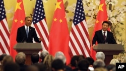 美國總統奧巴馬(左)和中國國家主席習近平(右)在聯合記者會上。