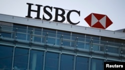 HSBC Holdings Plc admitted on February 8, 2015 failings by its Swiss subsidiary, in response to media reports it helped wealthy customers dodge taxes and conceal millions of dollars of assets. REUTERS/Pierre Albouy (SWITZERLAND -