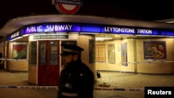 Police officers investigate a crime scene at Leytonstone Underground station in east London, Britain, Dec. 6, 2015.