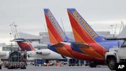 FILE - Southwest Airlines are seen parked at a gate in Tacoma International Airport in Seattle.