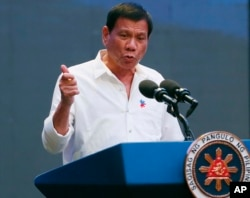 FILE - Philippine President Rodrigo Duterte gestures during his address to a Filipino business sector in suburban Pasay city south of Manila, Philippines, Oct. 13, 2016.