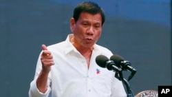 FILE - Philippine President Rodrigo Duterte gestures during his address to a Filipino business sector in suburban Pasay city south of Manila, Philippines.