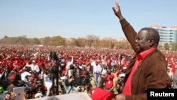 Prime Minister Morgan Tsvangirai, the leader of Zimbabwe's opposition party Movement For Democratic Change (MDC), greets supporters at a rally in Harare, July 29, 2013.