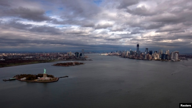 FILE - An aereal view of the Statue of Liberty, Liberty Island and Ellis Islands (L), next to New York's Lower Manhattan skyline, New York.