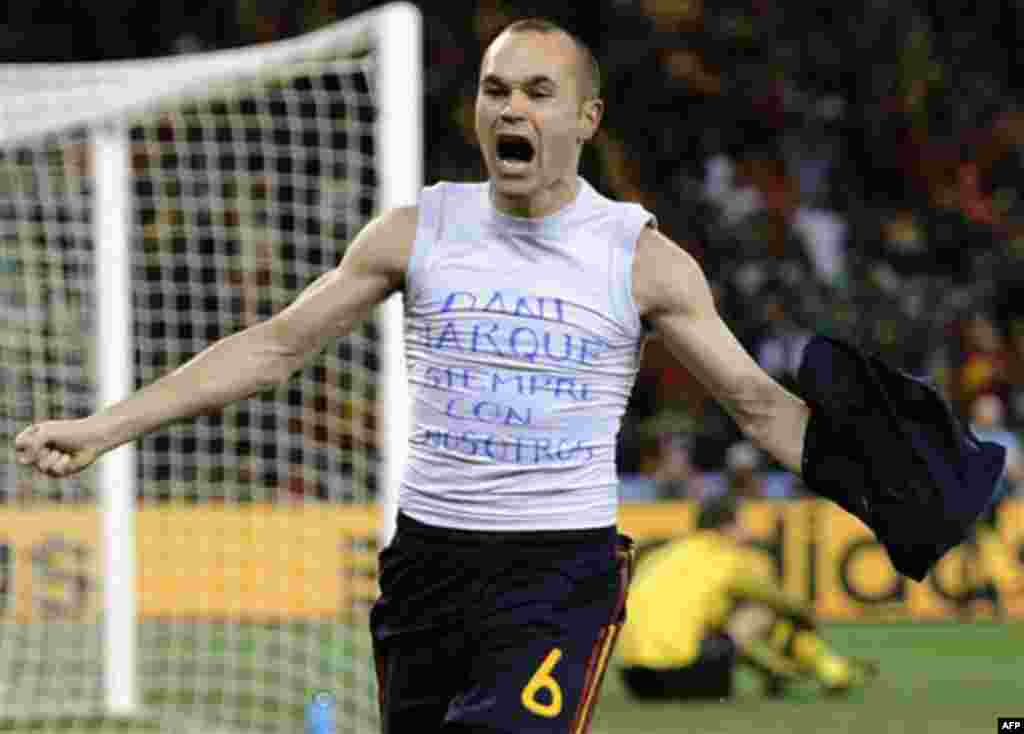 "Spain's Andres Iniesta celebrates after scoring a goal, with the words ""Dani Jarque, always with us"", written on his undershirt, during the World Cup final soccer match between the Netherlands and Spain at Soccer City in Johannesburg, South Africa, Sunday"