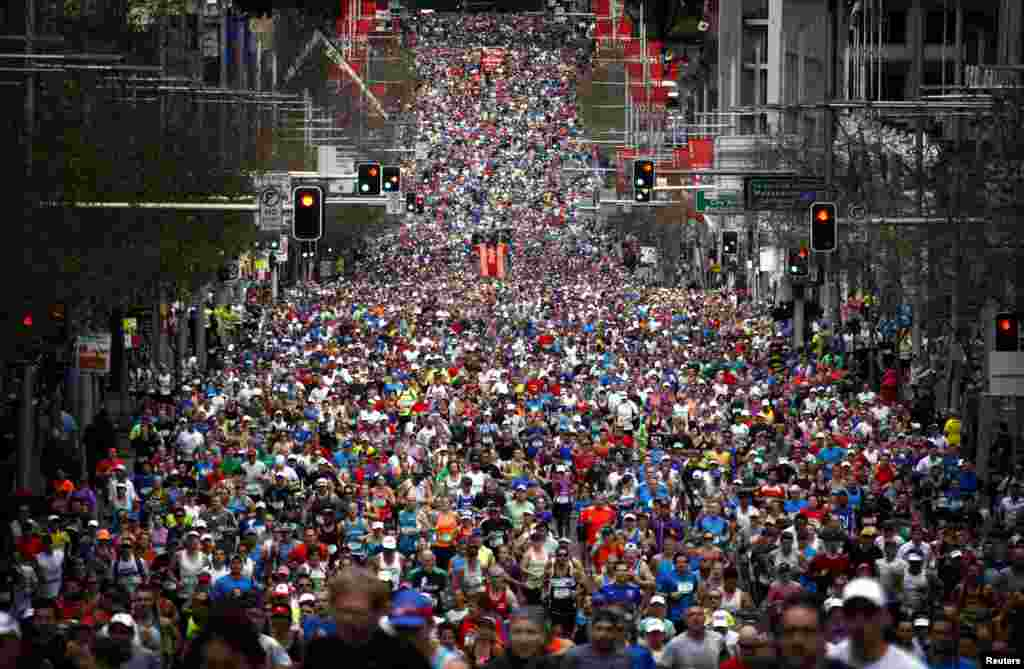 Runners start the 44th annual City2Surf fun run down Sydney's William Street, Australia. Around 80,000 people participated in the run, which covers a distance of 14km (8.7 miles) from the city to Bondi Beach.