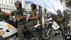 Soldiers patrol outside a polling station in Guatemala City, September 10, 2011.