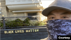 James Juanillo stands in front of his home in San Francisco.
