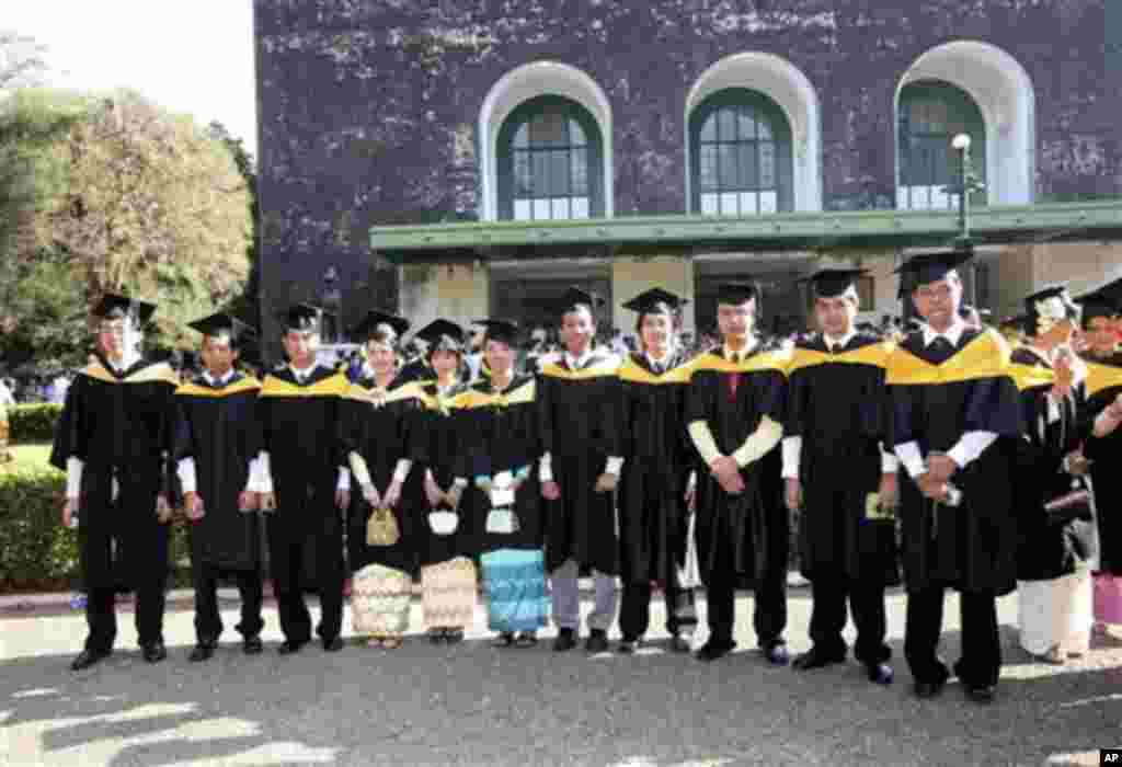 In this photo taken on April 5, 2008, graduated students pose for photos outside the convocation hall in the main campus of Yangon University in Yangon, Myanmar. The university was once one of Asia's finest and a poignant symbol of an education system cri