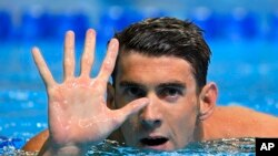 Michael Phelps gestures after winning the men's 200-meter butterfly at the U.S. Olympic swimming trials, Wednesday, June 29, 2016, in Omaha, Neb. Phelps qualified for his fifth Summer Games.