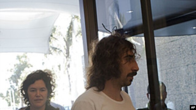 Freed American freelance journalist Clare Morgana Gillis, left and Spanish photographer Manu Brabo arrive to a hotel where most of international media stays in Tripoli, Libya, May 18, 2011.