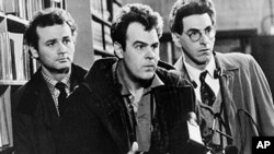 "FILE - In an undated file photo, Bill Murray, Dan Aykroyd, center, and Harold Ramis, right, appear in a scene from the 1984 movie ""Ghostbusters."""