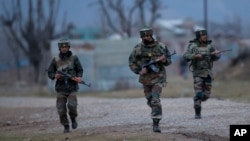 Indian army soldiers arrive at the site of a gun battle, on the outskirts of Srinagar, Indian-controlled Kashmir, Feb. 20, 2016.