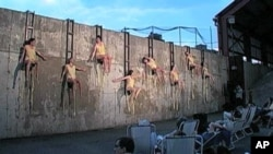 In 'Melt' dancers seem pinned to a concrete wall and appear to drip mellting beeswax