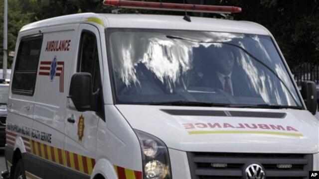 The ambulance carrying former South African President Nelson Mandela leaves Milpark hospital in Johannesburg, South Africa, Jan 28, 2011