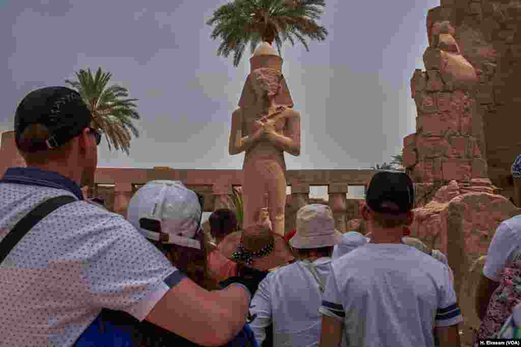 A week after Egypt received the first Russian airline flight after a two-year hiatus, a group of tourists listen to their guide in Karnak temple in Luxor, Egypt, April 20, 2018.