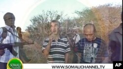 A screengrab from a new video showing captured South Korean sailors being held for ransom and leverage by Somali pirates, March 2012.