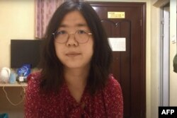 This screengrab taken on December 28, 2020 from an undated video showing former Chinese lawyer and citizen journalist Zhang Zhan as she broadcasts via YouTube, at an unconfirmed location in China.
