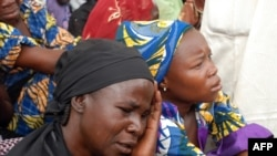 Mothers of the missing Chibok school girls abducted by Boko Haram Islamists gather to receive informations from officials, May 5, 2014.