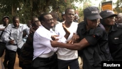 Ugandan police arrested opposition leader Kizza Besigye and supporters before a political rally in July, 2012 in the capital, Kampala.
