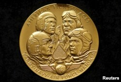 FILE - The Congressional Gold Medal to recognize the American Fighter Aces' service to the United States throughout the history of aviation warfare on display, in Washington D.C., May 20, 2015.