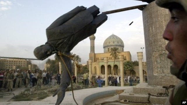 Saddam Hussein's statue is taken down in Baghdad's Firdos Square April 9, 2003 after U.S. and allied troops enter the Iraqi capital.