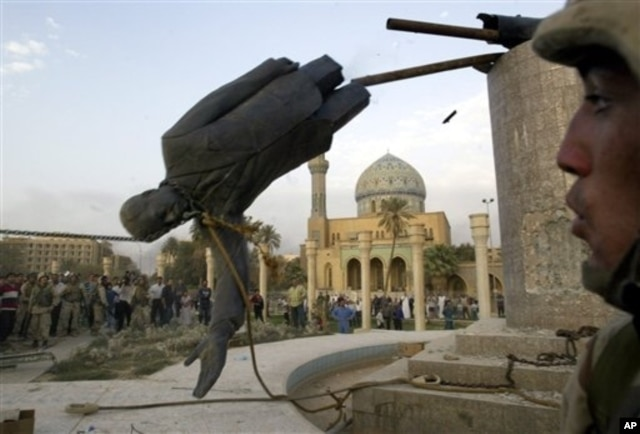 Saddam Hussein's statue is taken down in Baghdad's Firdos Square April 9, 2003, after U.S. and allied troops enter the Iraqi capital.
