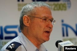 FILE - Major-General Amos Yadlin, Israel's chief of military intelligence, speaks at the annual Institute for National Security Studies (INSS) conference in Tel Aviv, Dec. 15, 2009.
