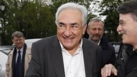 Former IMF head Dominique Strauss-Kahn (C) and Deputy Mayor of Sarcelles Francois Pupponi (2nd R), arrive at a polling station in the second round of the 2012 French presidential elections in Sarcelles, May 6, 2012.
