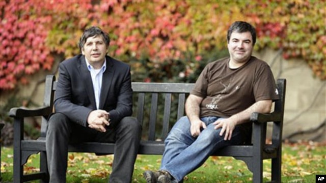 Professor Andre Geim, left, and Dr. Konstantin Novoselov, who have been awarded the Nobel Prize for Physics, pose for pictures outside Manchester University, Manchester, England,  05 Oct 2010