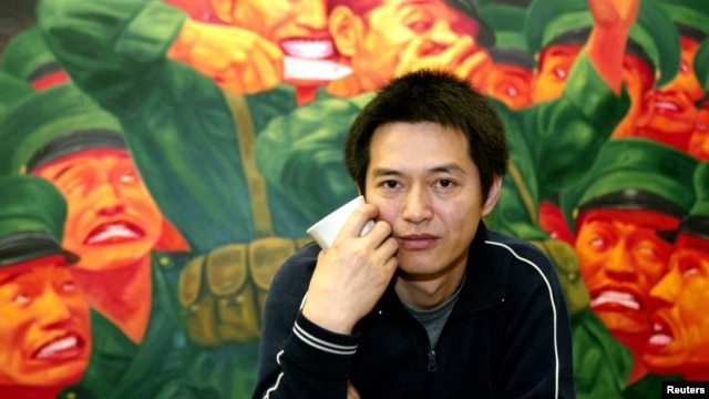 FILE - Chinese-born artist Guo Jian is pictured in front of one of his paintings on show in his Sydney studio.